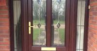 dark-brown-front-door-with-gold-handle-somerset