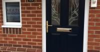 dark-brown-front-door-with-white-night-lamp
