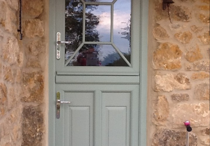 rectangular-green-front-door-with-square-patterned-window