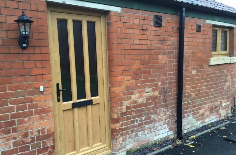 light-brown-front-door-with-black-thin-panels