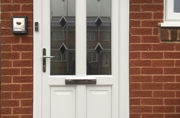 white-front-door-with-patterned-duo-panels