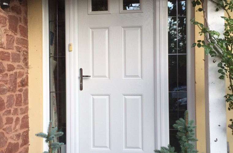 white-front-door-with-small-square-window-panels