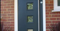 dark-grey-front-door-with-square-window-panels-and-silver-handle
