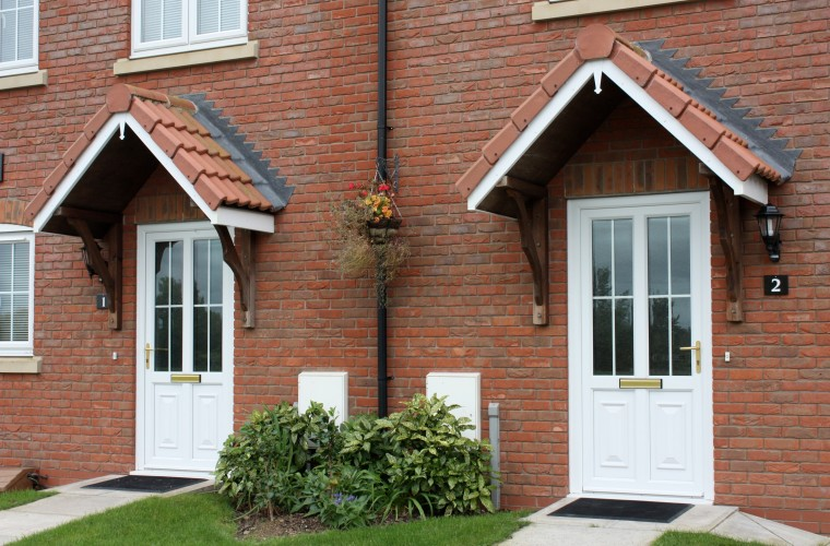 pair-of-white-front-doors-with-front-garden-somerset