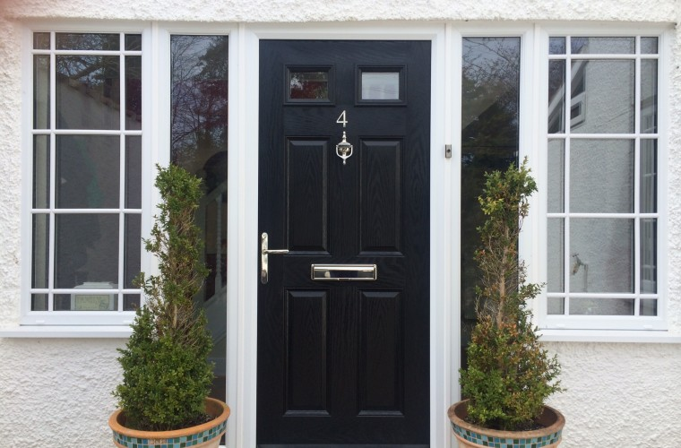 blacl-front-door-with-thin-bushes-either-side-somerset