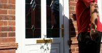 notaro-windows-staff-fitting-white-arched-front-door-somerset