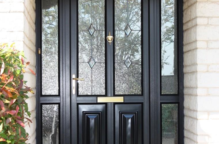 black-front-door-with-marbled-window-panels