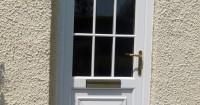 white-wooden-front-door-with-nine-window-panels