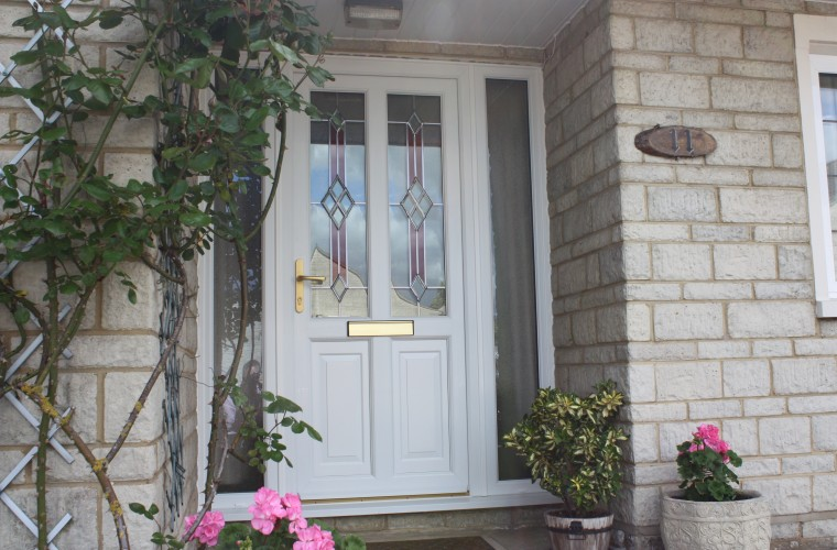 white-front-door-with-foliage-surround
