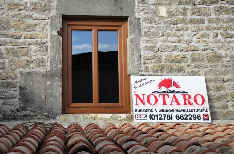 tan-brown-wood-effect-upvc-window-with-novaro-windows-sign