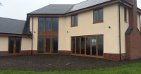beige-house-with-tan-wood-effect-upvc-windows-in-somerset