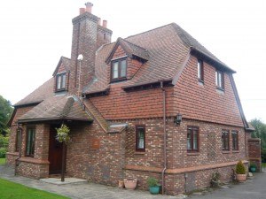 large-brick-house-with-wood-effect-upvc-windows