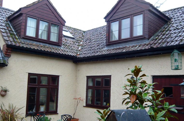 dark-brown-woof-effect-upvc-windows-on-house-in-somerset