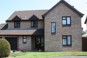 house-with-wood-effect-upvc-windows-on-green-grass-in-somerset
