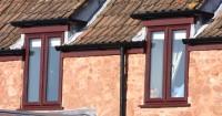 orange-house-with-wood-effect-upvc-windows