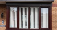 four-dark-brown-wood-effect-upvc-windows-notaro-windows