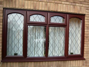 dark-brown-leaded-windows-with-arched-rim